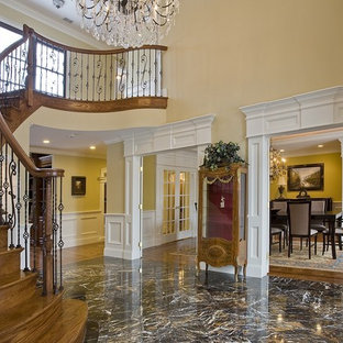 Staircase - traditional wooden curved mixed material railing staircase idea in Boston with wooden risers