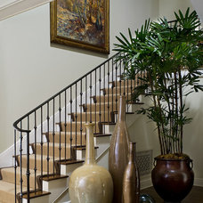 Eclectic Staircase by Tommy Chambers Interiors, Inc.