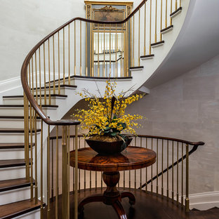Staircase - traditional wooden curved staircase idea in Toronto with painted risers