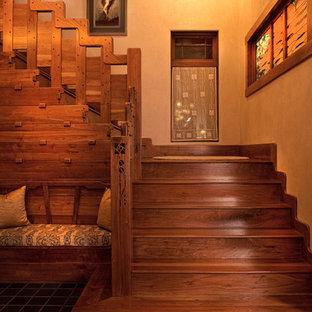 """Idee per una grande scala a """"L"""" rustica con pedata in legno e alzata in legno"""