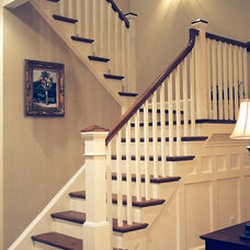 traditional staircase by Artistic Design and Construction, Inc