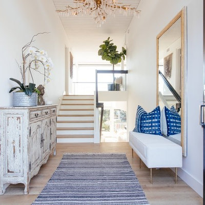 Staircase - mid-sized coastal wooden u-shaped glass railing staircase idea in Orange County with painted risers