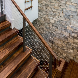 Inspiration for a mid-sized rustic wooden u-shaped staircase remodel in Other with wooden risers