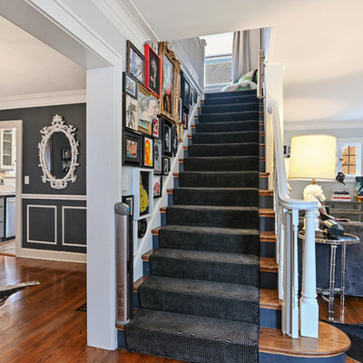 Inspiration for an eclectic wooden straight wood railing staircase remodel in Kansas City with painted risers