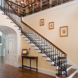 Staircase - mid-sized traditional painted l-shaped mixed material railing staircase idea in Atlanta with wooden risers