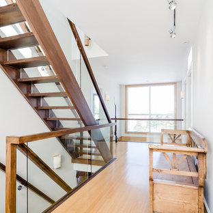 Example of a large trendy wooden straight glass railing staircase design in Boston with glass risers