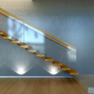Idéer för att renovera en mellanstor funkis rak trappa i trä, med öppna sättsteg