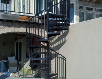 Outside iron spiral staircase to back porch