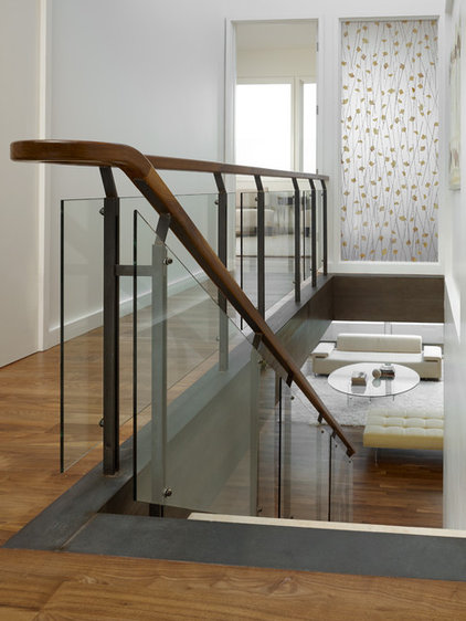 rustic staircase by John Maniscalco Architecture