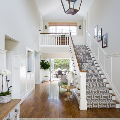 Inspiration for a large transitional wooden straight staircase remodel in Los Angeles