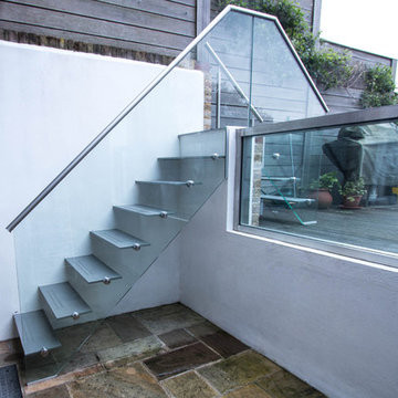 Painted mild steel construction open string-riser external access staircase