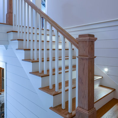 Inspiration for a large cottage wooden u-shaped wood railing staircase remodel in Atlanta with painted risers