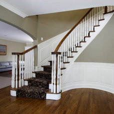 Traditional Staircase by Fanatic Finish Inc.