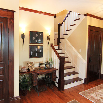 Mid-sized cottage wooden u-shaped staircase photo in Other with painted risers