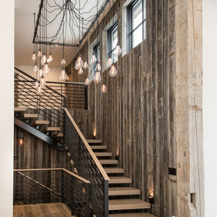 Staircase - rustic wooden l-shaped open staircase idea in Salt Lake City