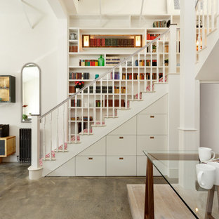 Contemporary l-shaped staircase in Other with wood railing.