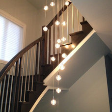 Contemporary Staircase by Premiere Luminaire