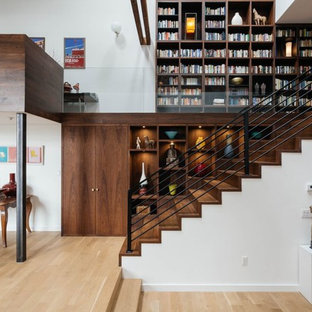 Inspiration for a mid-sized contemporary wooden straight staircase remodel in New York with wooden risers
