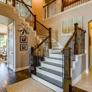 Example of a large transitional wooden u-shaped mixed material railing staircase design in Dallas with painted risers
