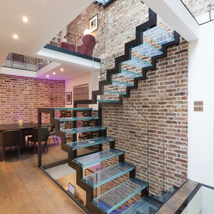 Photo of an urban glass u-shaped glass railing staircase in London with open risers.