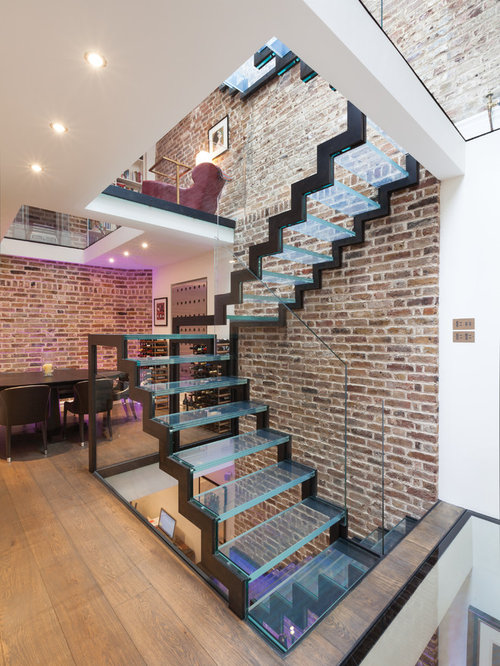 Photo Of An Urban Glass U Shaped Glass Railing Staircase In London With  Open Risers