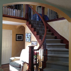 Mediterranean Staircase by Ironwood Custom Builders, Inc