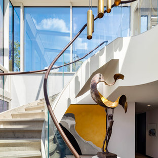 Inspiration for a mixed contemporary curved staircase in London.