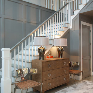 Inspiration for a mid-sized transitional painted curved wood railing staircase remodel in New York with painted risers