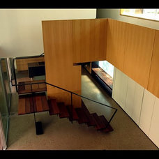 Modern Staircase by M. J. Neal Architects, LLC.