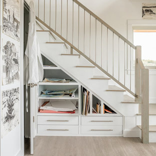 Example of a beach style wooden l-shaped mixed material railing staircase design in Portland Maine with painted risers