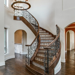 Photo of a mediterranean wood curved metal railing staircase in Dallas with tiled risers.