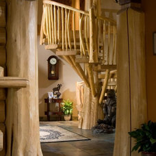 Rustic Staircase by Summit Log & Timber Homes