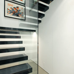 modern staircase by Dyna Contracting