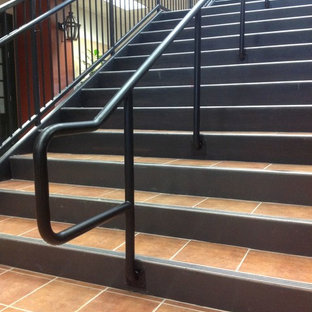Inspiration for a large contemporary tile straight staircase remodel in New Orleans with metal risers