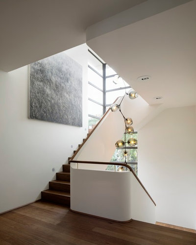 Contemporary Staircase by Decus Interiors