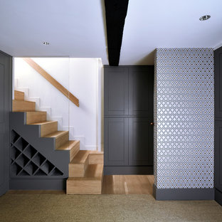 Inspiration for a medium sized contemporary wood straight staircase in London with wood risers.