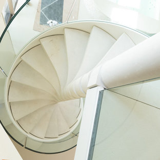 Inspiration for a contemporary concrete curved glass railing and open staircase remodel in Cambridgeshire