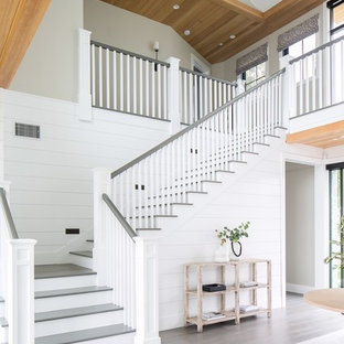 Inspiration for a mid-sized transitional painted l-shaped wood railing staircase remodel in Orange County with painted risers