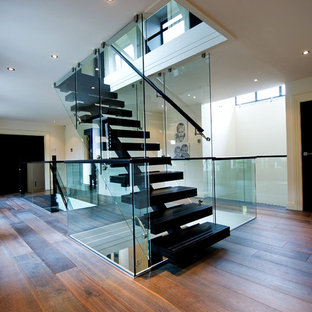 Contemporary floating staircase in Other with open risers.