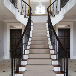 Design ideas for a traditional wood straight staircase in Devon with painted wood risers.