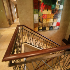Eclectic Staircase by SKD Architects