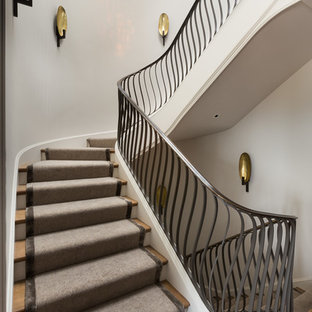 Staircase - large transitional wooden curved staircase idea in San Francisco with painted risers