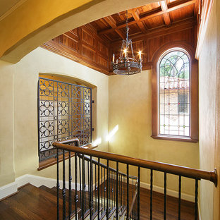 Inspiration for a mediterranean wooden u-shaped staircase remodel in Dallas
