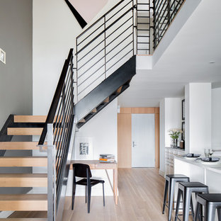 Inspiration for a scandinavian wooden l-shaped open staircase remodel in New York