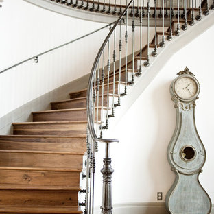Example Of A Classic Wooden Curved Metal Railing Staircase Design In Salt  Lake City
