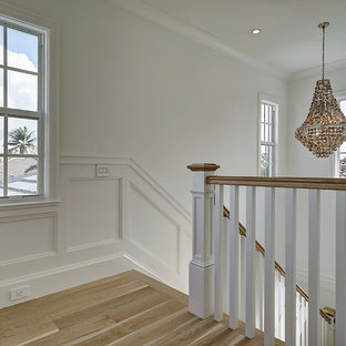 Staircase - mid-sized beach style l-shaped wood railing staircase idea in Miami