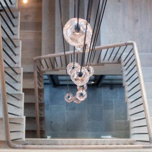 Ejemplo de escalera suspendida y madera, clásica renovada, grande, sin contrahuella, con escalones de madera, barandilla de varios materiales y madera