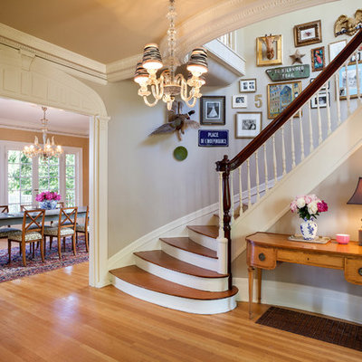 Example of a classic wooden curved staircase design in Portland