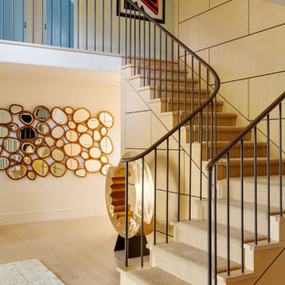 Inspiration for a mid-sized transitional wooden l-shaped wood railing staircase remodel in Boston with wooden risers