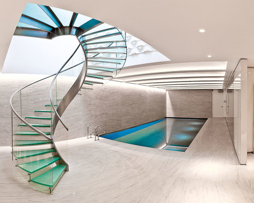 Example Of A Trendy Glass Spiral Glass Railing Staircase Design In London